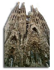 Anton Gaudi - The completed east transept of the Sagrada Familia with its four towers and three portals.
