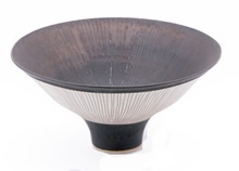 antique marks - LUCIE RIE Flaring porcelain bowl radiating with sgraffito lines on bronze glaze interior and matte white exterior. Marked LR