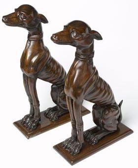Matching pair of antique bronze mahogany venetian dogs