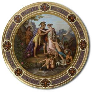 An early 20th century Vienna circular charger the gilt border with stylised foliate bands and cartouche panels, the well painted with a neo-Classical scene of Peleus and Thetis, with cherubic figures with fortresses in the background, overpainted blue beehive mark and painted 'Peleus u Thetis', and impressed Z over 4 - auction estimate £800-1,200