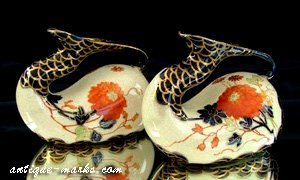Ernst Wahliss Pair of swan necked spill vases