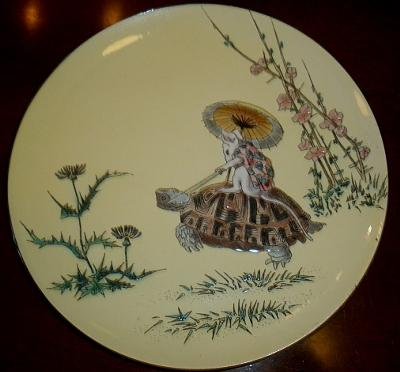 Antique enamel plate with tortoise and mouse