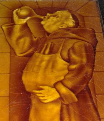 antique-tiles with drinking-monk