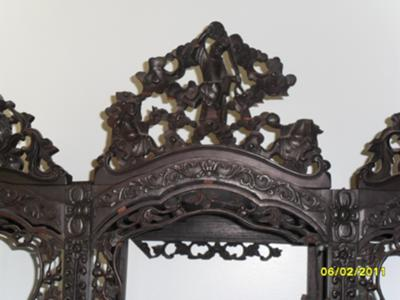 Central head piece on Chinese Curio