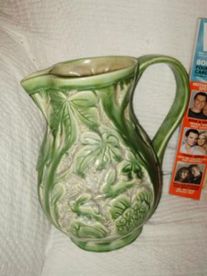 green-pottery-jug-with-rabbits