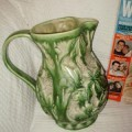 Right side of green pottery jug
